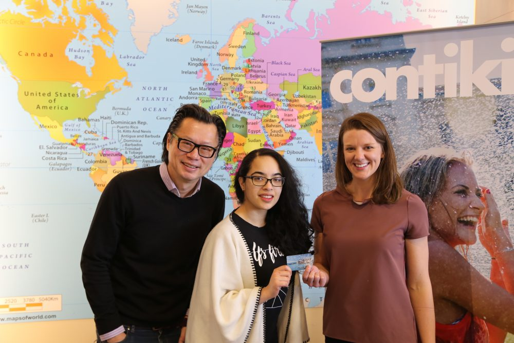 Break Escape contest winner, Christine Soares picking up her prize at Merit Travel