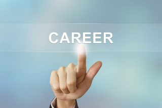 business hand pushing career button on blurred background